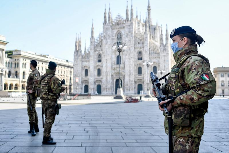 Soldiers patrol in front of the Duomo gothic cathedral in Milan, Italy: AP