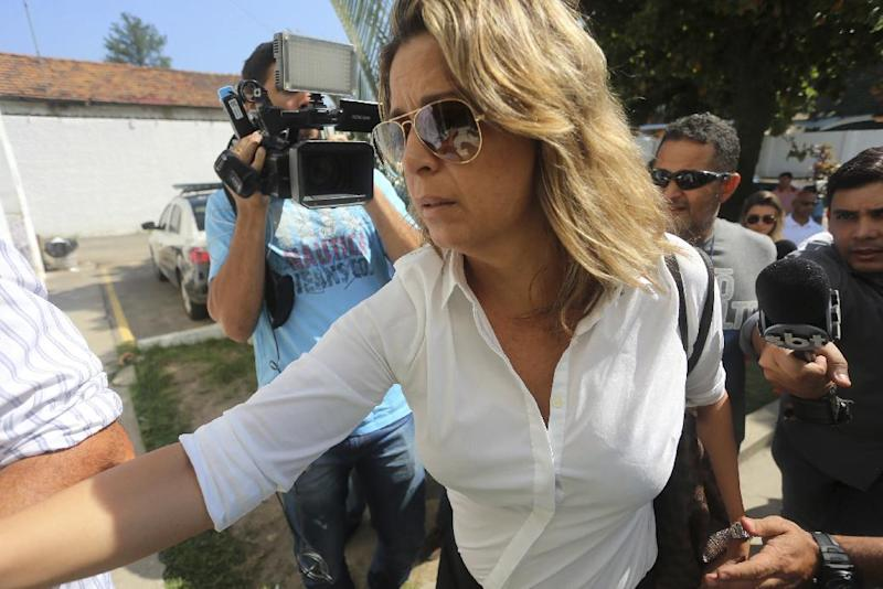 Francoise Amiridis, the wife of Greece's Ambassador to Brazil Kyriakos Amiridis, arrives at a police station to be interrogated in connection with her husband's disappearance in Belford Roxo, Brazil, Friday, Dec. 30, 2016. Authorities believe that the ambassador was killed at the home his wife kept in the Rio de Janeiro area, after he went missing on Monday in the city of Nova Iguacu, just north of Rio de Janeiro. (Fabiano Rocha/Extra Ag O Globo via AP)