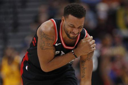 Nov 5, 2018; Salt Lake City, UT, USA; Toronto Raptors forward Norman Powell (24) reacts to injuring his shoulder in the second quarter against the Utah Jazz at Vivint Smart Home Arena. Mandatory Credit: Jeff Swinger-USA TODAY Sports