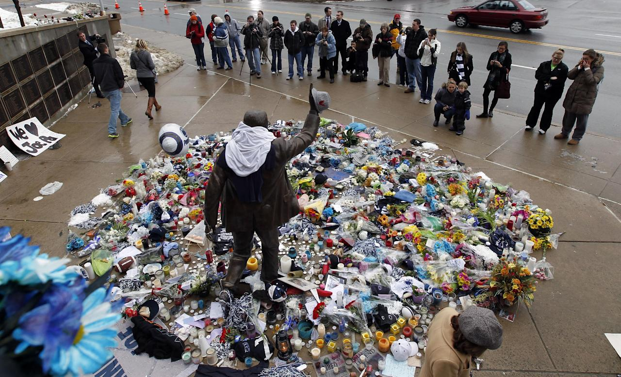 Tributes surround a statue of Penn State football coach Joe Paterno, outside Beaver Stadium on the Penn State campus Monday, Jan. 23, 2012 in State College, Pa. Paterno died Sunday morning. (AP Photo/Alex Brandon)