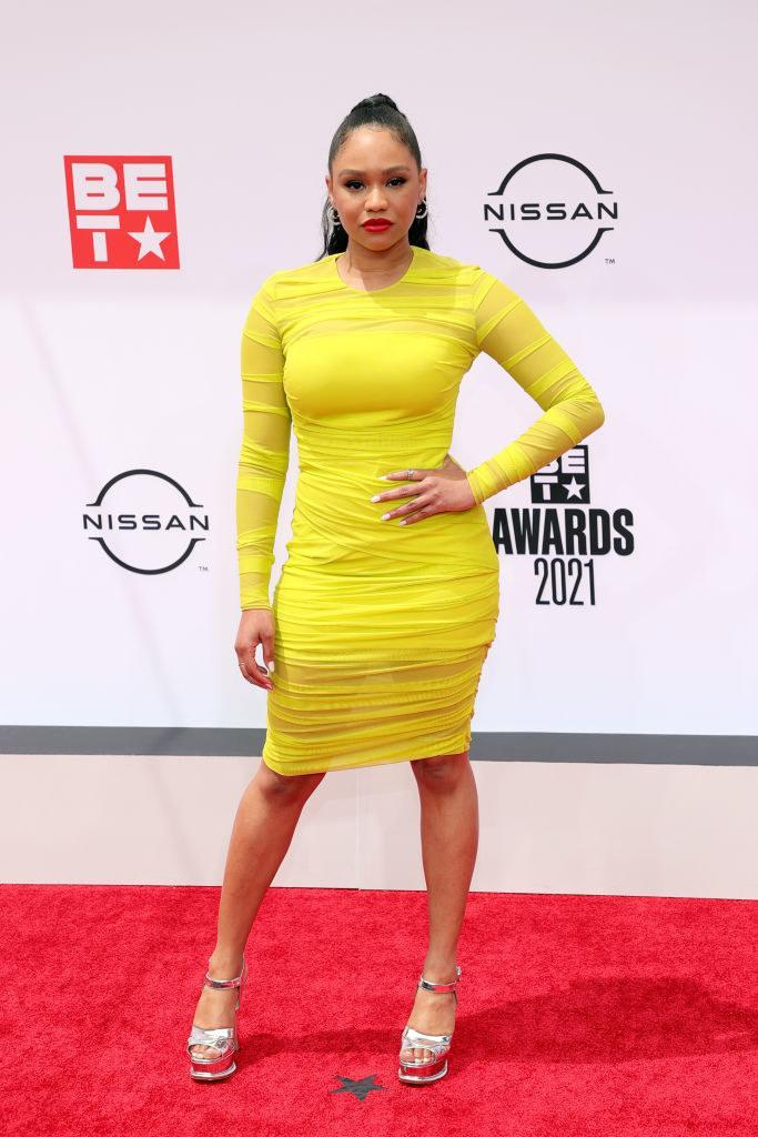 Tanisha Long attends the BET Awards 2021 in a short, long-sleeved dress