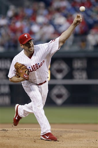Philadelphia Phillies' Cliff Lee pitches in the first inning of a baseball game against the New York Mets, Wednesday, May 9, 2012, in Philadelphia. (AP Photo/Matt Slocum)