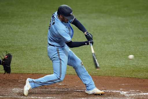 Toronto Blue Jays' Danny Jansen connects for a solo home run, his second of the day, off Tampa Bay Rays starting pitcher Tyler Glasnow during the fifth inning of Game 2 of an American League wild-card baseball series Wednesday, Sept. 30, 2020, in St. Petersburg, Fla. (AP Photo/Chris O'Meara)