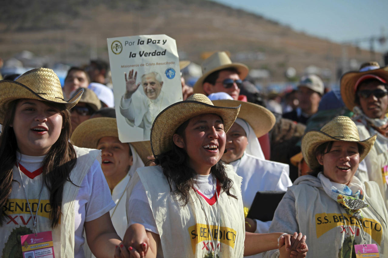 Pilgrims cheer and sing as they wait at the site where Pope Benedict XVI will give a Mass in Bicentennial Park near Silao, Mexico, Sunday March 25, 2012. (AP Photo/Dario Lopez-Mills)