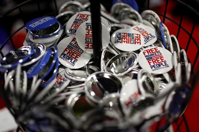 <p>Buttons calling for free markets are displayed at the Conservative Political Action Conference (CPAC) at National Harbor, Md., Feb. 23, 2018. (Photo: Joshua Roberts/Reuters) </p>
