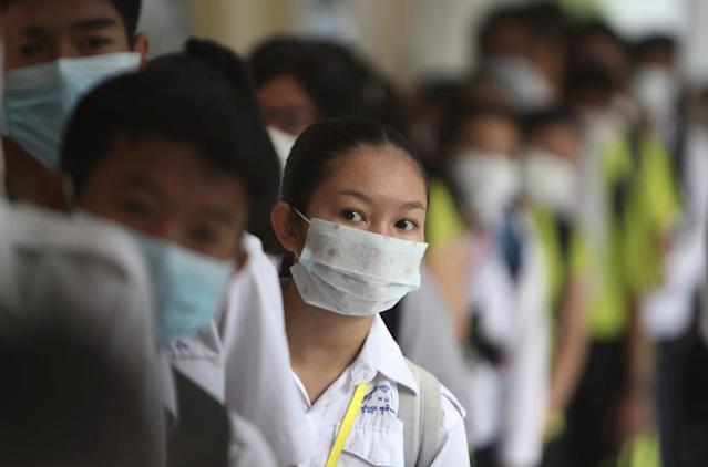 <p>Students line up to sanitize their hands to avoid the contact of coronavirus before their morning class at a hight school in Phnom Penh, Cambodia, Tuesday, Jan. 28, 2020. (AP Photo/Heng Sinith)</p>