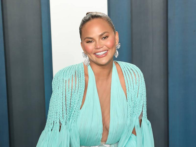 Chrissy Teigen gets fans to vote for at-home concert outfit