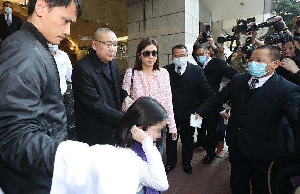 Joseph Lau (second Left) and his wife Chan Hoi-wan leave China Evergrande Centre in Wan Chai, Hong Kong, in a March 2017 file picture. Photo: Edward Wong