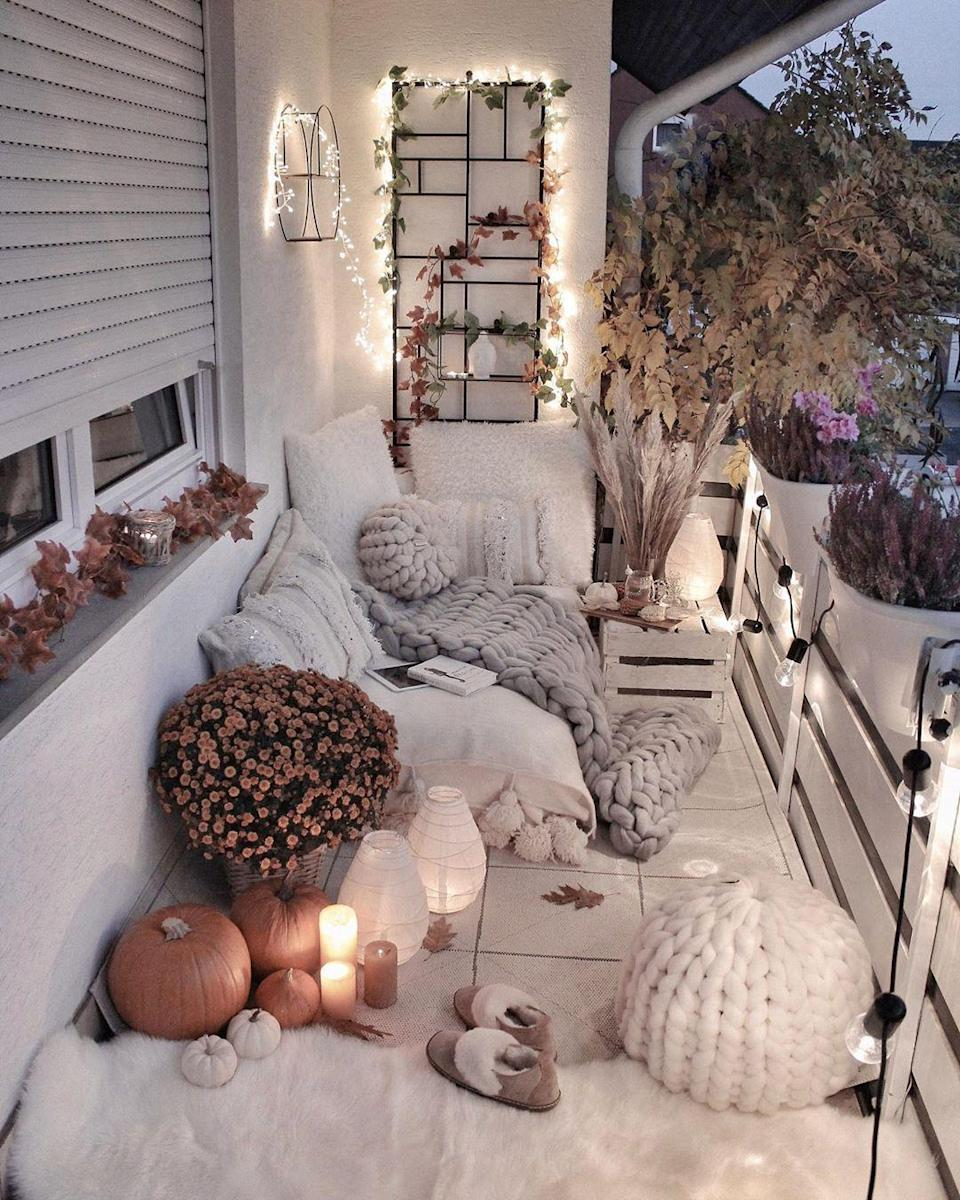 """<p>Just because it's chillier in the fall doesn't mean you can't sit outdoors. With this well-lit set-up, you'll be able to cozy up with your loved ones while enjoying the seasonal weather.</p><p><strong>See more at <a href=""""https://www.instagram.com/p/B3Xg2OYCK5P/"""" rel=""""nofollow noopener"""" target=""""_blank"""" data-ylk=""""slk:gozdee81"""" class=""""link rapid-noclick-resp"""">gozdee81</a>.</strong></p><p><a class=""""link rapid-noclick-resp"""" href=""""https://www.amazon.com/String-Lights-Bulbs-UL-Outdoor-Commercial/dp/B01MA43D7R/?tag=syn-yahoo-20&ascsubtag=%5Bartid%7C10050.g.31137877%5Bsrc%7Cyahoo-us"""" rel=""""nofollow noopener"""" target=""""_blank"""" data-ylk=""""slk:SHOP BLACK STRING LIGHTS""""><strong>SHOP BLACK STRING LIGHTS</strong></a></p>"""