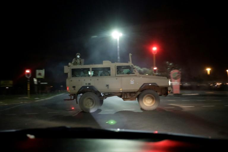 South Africa has begun an lockdown that will be patrolled by the military and will see any disobeying the rules heavily punished (AFP Photo/Marco Longari)