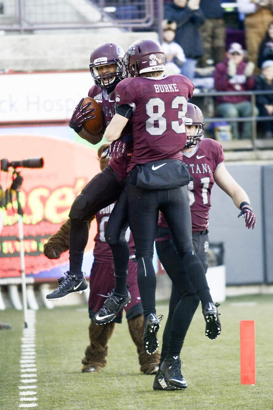 Montana wide receiver Jamaal Jones (6) celebrates his touchdown with wide receiver Ryan Burke (83) during the first half of an NCAA college football playoff game, Saturday, Nov. 29, 2014, in Missoula, Mont. (AP Photo/Lido Vizzutti)