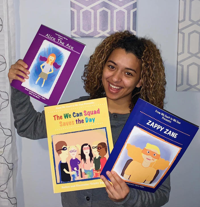 Trinity Jagdeo with the books she has written and illustrated to showcase superheroes with disabilities. (Courtesy Trinity Jagdeo)