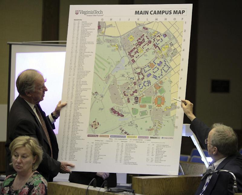 """Defense attorney William """"Bill"""" Broaddus, left, holds an enlarged map of the Virginia Tech campus as vice president of student affairs, Ed Spencer, right, comments on it in Montgomery County Circuit Court in Christiansburg, Va., Monday March 12 2012. Spencer was describing walking from his office on campus to a dorm room crime scene the morning of April 16, 2007.    (AP Photo / The Roanoke Times, Matt Gentry)"""