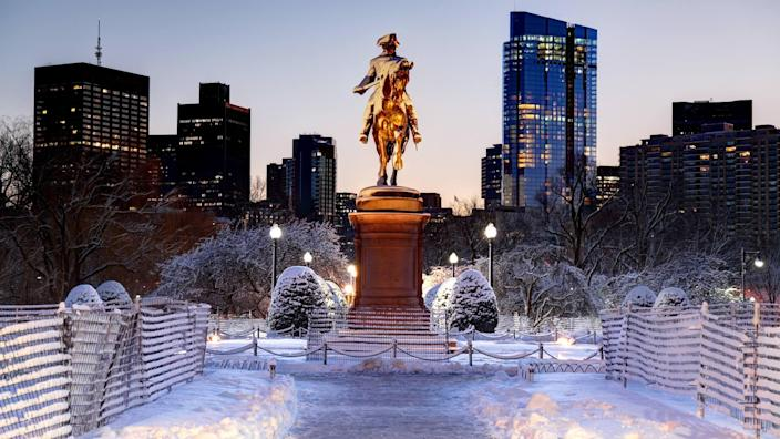 Boston Public Garden in the winter with the  Equestrian statue of George Washington designed by Thomas Ball.