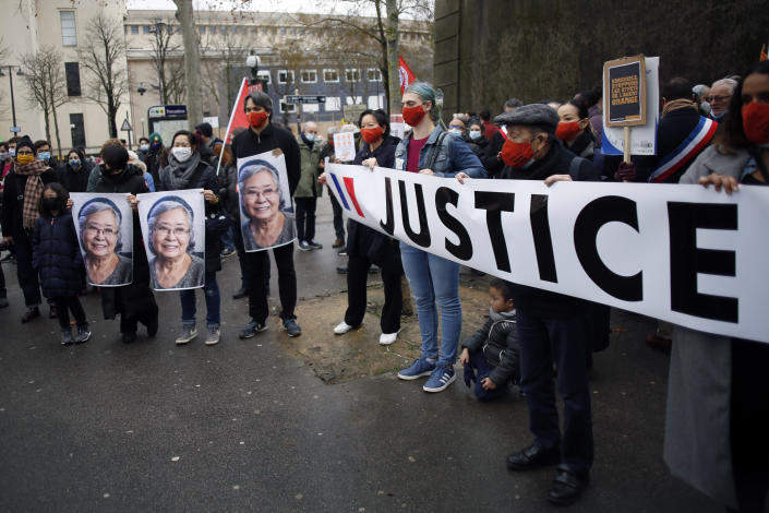 Activists hold pictures of Tran To Nga, a 78-year-old former journalist, during a gathering in support of people exposed to Agent Orange during the Vietnam War, in Paris, Saturday Jan. 30, 2021. Activists gathered Saturday in Paris in support of people exposed to Agent Orange during the Vietnam War, after a French court examined a case opposing a French-Vietnamese woman to 14 companies that produced and sold the toxic chemical. (AP Photo/Thibault Camus)