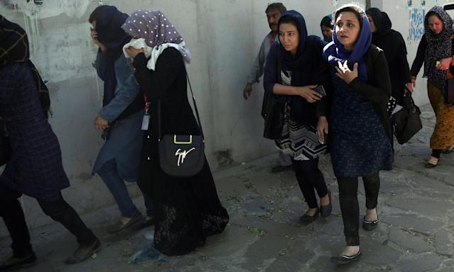 <p>Roshan mobile company employees leave the site of a suicide attack in Kabul, Afghanistan, Wednesday, May 31, 2017. (AP Photos/Massoud Hossaini) </p>