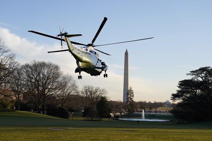 Marine One, with President Donald Trump and first lady Melania Trump aboard, lifts off the South Lawn of the White House, Wednesday, Dec. 23, 2020, in Washington, enroute to Andrews Air Force Base and then onto Florida. (AP Photo/Evan Vucci)