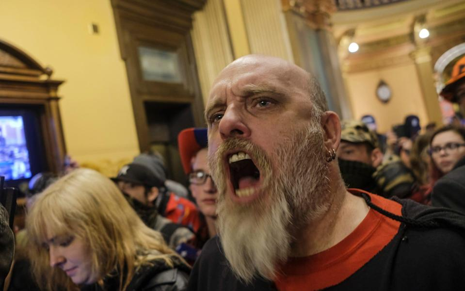 A protester in America voices his disapproval at lockdown measures - BLOOMBERG