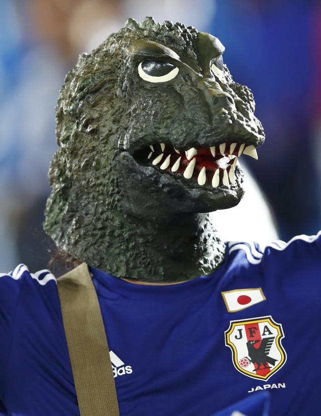 A fan of Japan wearing a 'Godzilla' mask waits before their 2014 World Cup Group C soccer match against Greece at the Dunas arena in Natal June 19, 2014. REUTERS/Toru Hanai (BRAZIL - Tags: SOCCER SPORT WORLD CUP)