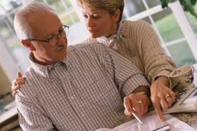 Older couple looking at papers