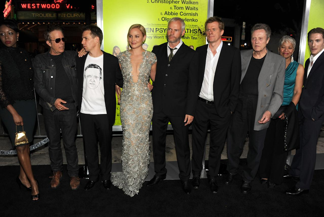 "WESTWOOD, CA - OCTOBER 01:  (L-R) Actors Amanda Warren, Tom Waits, Sam Rockwell, Abbie Cornish, writer/director Martin McDonagh, producer Graham Broadbent, actors Christopher Walken, Linda Bright Clay, and James Hebert arrive at the premiere of CBS Films' ""Seven Psychopaths"" at Mann Bruin Theatre on October 1, 2012 in Westwood, California.  (Photo by Kevin Winter/Getty Images)"