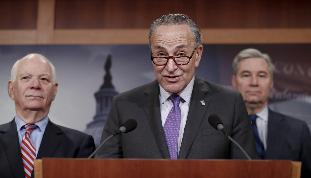Senate Minority Leader Charles Schumer of N.Y., joined by Sen. Sheldon Whitehouse, D-R.I., right, and Sen. Ben Cardin, D-Md., left, speaks during a news conference about the Paris climate agreement, Wednesday, May 24, 2017, on Capitol Hill in Washington. (AP Photo/Carolyn Kaster)