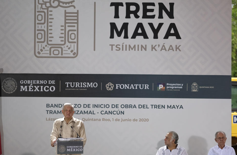 """Mexican President Andres Manuel Lopez Obrador, left, speak during a ceremony in Lazaro Cardenas, Quintana Roo state, Mexico, Monday, June 1, 2020. Amid a pandemic and the remnants of a tropical storm, President Lopez Obrador kicked off Mexico's return to a """"new normal"""" Monday with his first road trip in two months as the nation began to gradually ease some virus-inspired restrictions. (AP Photo/Victor Ruiz)"""