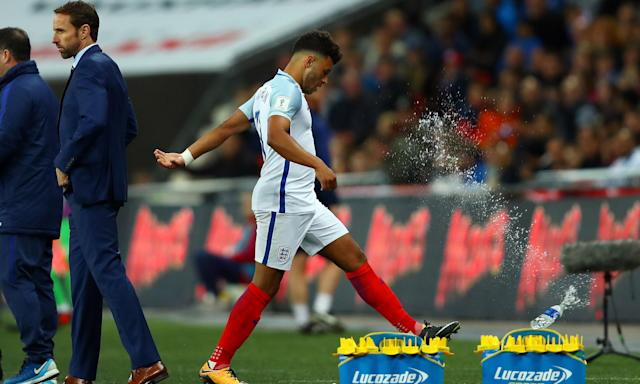 Alex Oxlade-Chamberlain reacts by kicking a bottle as he is substituted during England's 1-0 win over Slovenia. The Liverpool player remains an enigma.