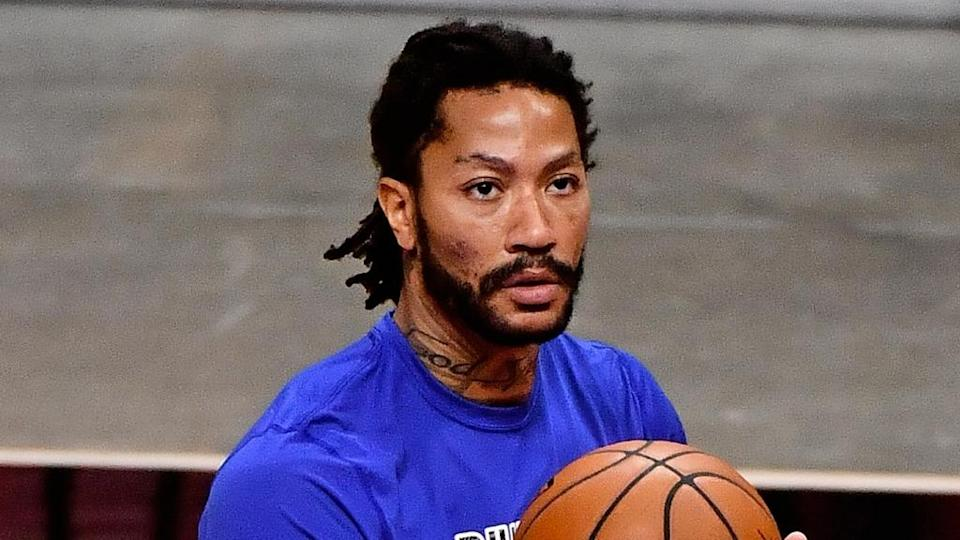 Derrick Rose holds ball during pregame warmups