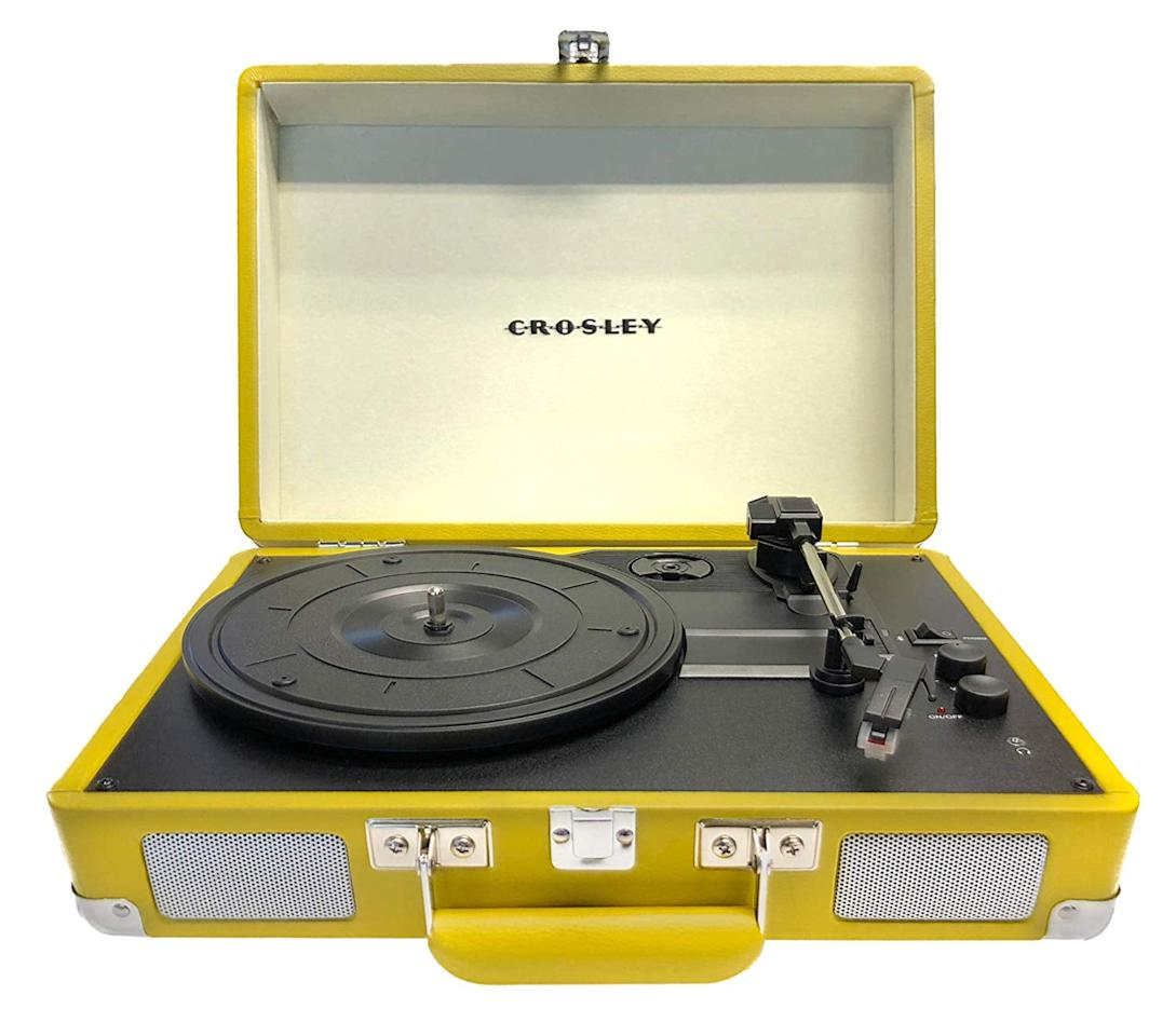 """<p>Put this <a href=""""https://www.popsugar.com/buy/Crosley-Cruiser-Deluxe-Portable-3-Speed-Turntable-476798?p_name=Crosley%20Cruiser%20Deluxe%20Portable%203-Speed%20Turntable&retailer=amazon.com&pid=476798&price=70&evar1=savvy%3Auk&evar9=46468516&evar98=https%3A%2F%2Fwww.popsugar.com%2Fsmart-living%2Fphoto-gallery%2F46468516%2Fimage%2F46468528%2FCrosley-Cruiser-Deluxe-Portable-3-Speed-Turntable&list1=shopping%2Cgift%20guide%2Cyellow%2Cgen%20z&prop13=api&pdata=1"""" rel=""""nofollow"""" data-shoppable-link=""""1"""" target=""""_blank"""" class=""""ga-track"""" data-ga-category=""""Related"""" data-ga-label=""""https://www.amazon.com/Crosley-CR8005D-Portable-Turntable-Bluetooth/dp/B07FFCST8X/ref=sr_1_3?crid=32G7BW0WAVT2E&amp;keywords=yellow+record+player&amp;qid=1565198097&amp;s=gateway&amp;sprefix=yellow+recor%2Caps%2C184&amp;sr=8-3"""" data-ga-action=""""In-Line Links"""">Crosley Cruiser Deluxe Portable 3-Speed Turntable </a> ($70) in your family room.</p>"""