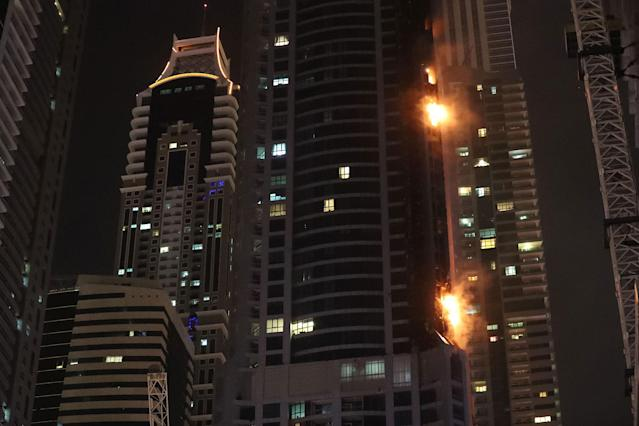 <p>Fire is seen at the 1,105 foot tall Torch tower skyscraper on August 4, 2017 in Dubai. (Photo: Karim Sahib/AFP/Getty Images) </p>