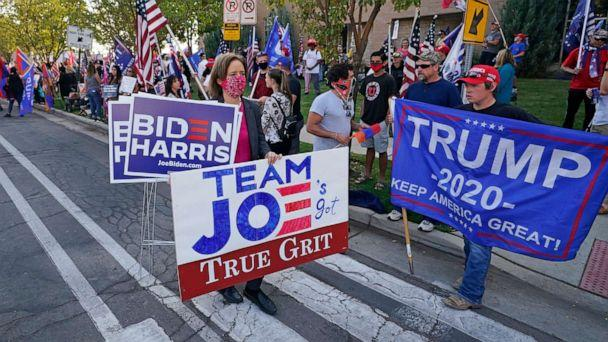 PHOTO: People holding signs in support gather near the site of the vice presidential debate between Vice President Mike Pence and Sen. Kamala Harris, at the University of Utah Oct. 7, 2020, in Salt Lake City. (Rick Bowmer/AP)