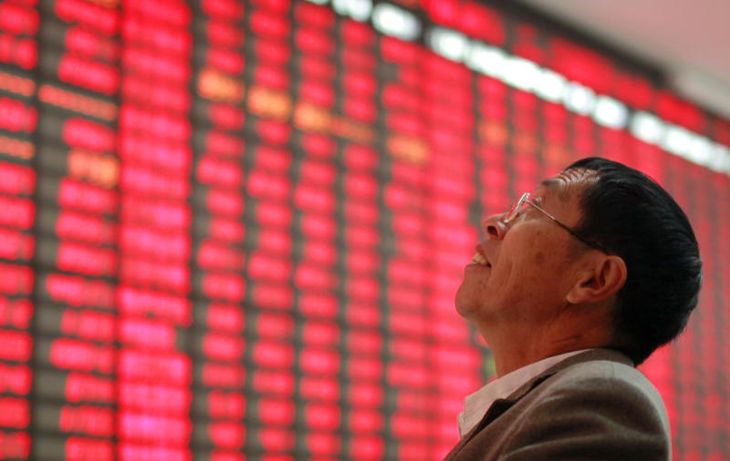 An investor monitors the stock prices at a private securities company Thursday, Nov. 1, 2012 in Shanghai, China. Asian stock markets were mixed Thursday, with investors buoyed by solid manufacturing data out of China but wary of weak global demand for electronics after Panasonic Corp. forecast a massive loss. (AP Photo)