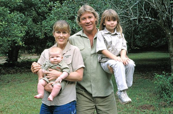 Bindi Irwin and Steve Irwin with a young Bindi and baby Robert