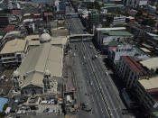 Quiapo church stands beside an almost empty road as the government implements a strict lockdown to prevent the spread of the coronavirus on Good Friday, April 2, 2021 in Manila, Philippines. Filipinos marked Jesus Christ's crucifixion Friday in one of the most solemn holidays in Asia's largest Catholic nation which combined with a weeklong coronavirus lockdown to empty Manila's streets of crowds and heavy traffic jams. Major highways and roads were eerily quiet on Good Friday and churches were deserted too after religious gatherings were prohibited in metropolitan Manila and four outlying provinces. (AP Photo/Aaron Favila)