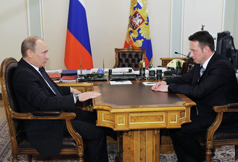 Russian President Vladimir Putin meets with Igor Kholmanskikh, right, a section head at the Uralvagonzavod tank factory in the Urals city of Nizhny Tagil that builds battle tanks, in Novo-Ogaryovo residence outside Moscow on Friday, May 18, 2012. President Vladimir Putin has given the senior government post to a tank factory worker who has offered to come to Moscow with fellow laborers to disperse opposition protests. (AP Photo/RIA Novosti, Yana Lapikova, Government Press Service)