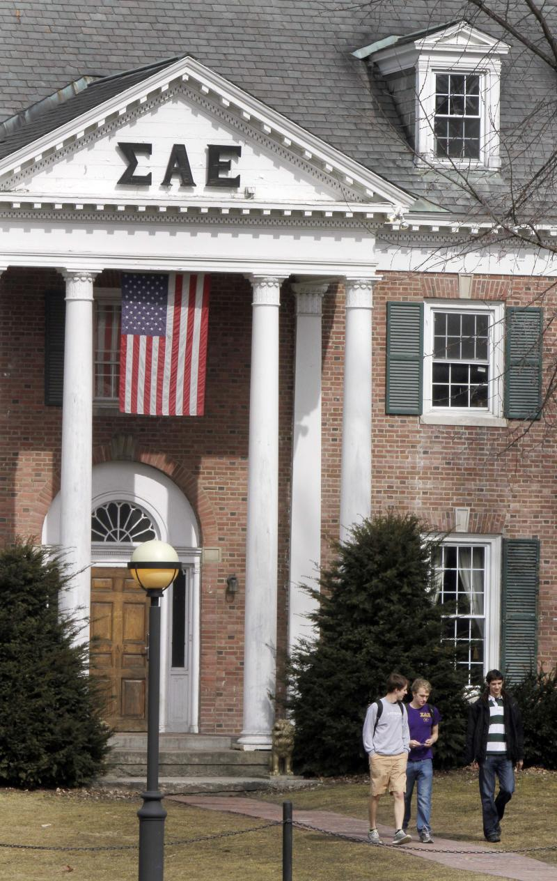 In this photo taken Monday March 12, 2012, students leave the Sigma Alpha Epsilon fraternity on the Dartmouth College campus in Hanover, N.H. More than a quarter of the fraternity's membership has been accused by the school's judicial council of hazing after a former member's public airing of  what he says he experienced as a pledge in 2009, including being forced to swim in a kiddie pool of vomit and other bodily fluids. (AP Photo/Jim Cole)