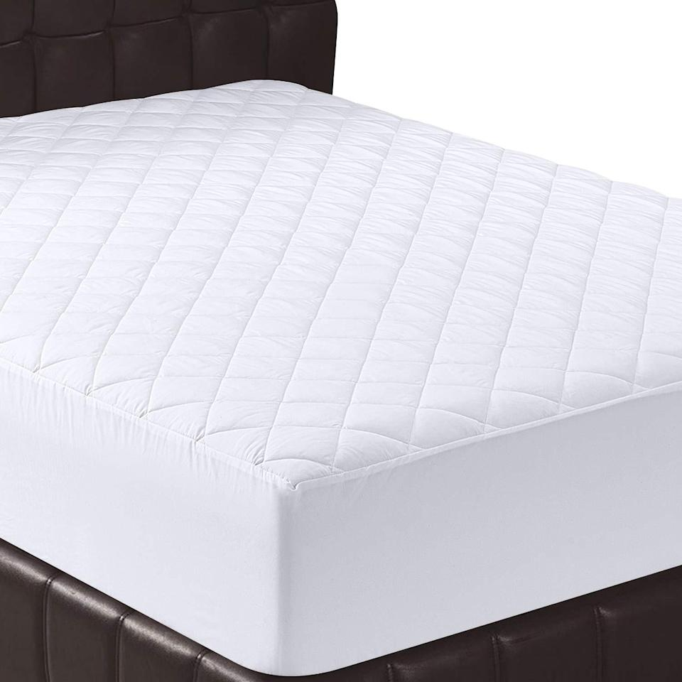 """<h2>Utopia Bedding Quilted Fitted Mattress Pad</h2><br><br><strong>Utopia Bedding</strong> Utopia Bedding Quilted Fitted Mattress Pad, $, available at <a href=""""https://amzn.to/34RuaNw"""" rel=""""nofollow noopener"""" target=""""_blank"""" data-ylk=""""slk:Amazon"""" class=""""link rapid-noclick-resp"""">Amazon</a>"""