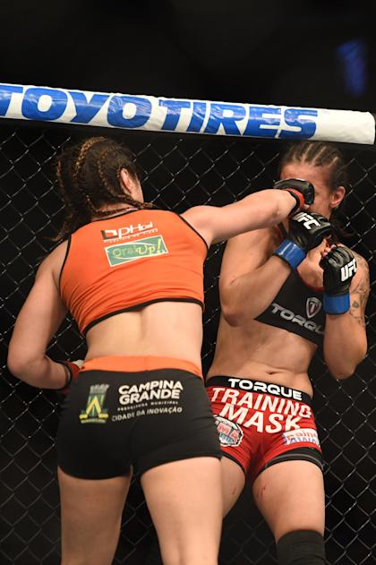 Correia (left) has now beaten two of Ronda Rousey's training partners. (USA Today)