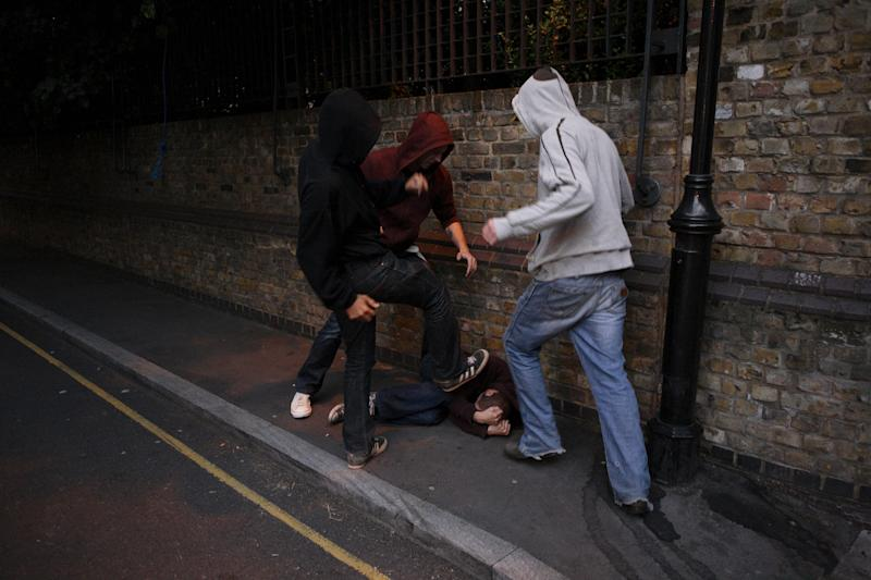 A gang of hoodies fighting (Photo: John Carey via Getty Images)