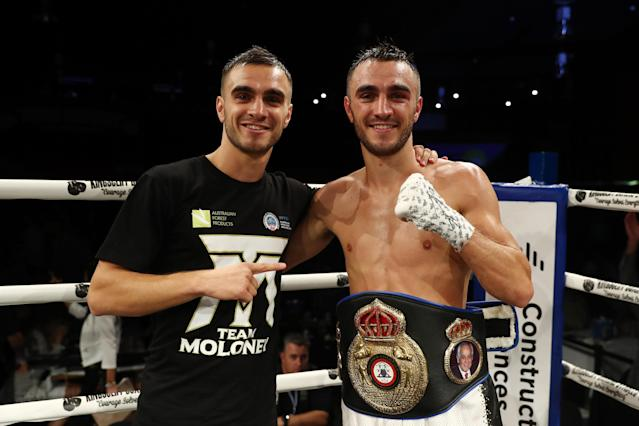 Jason Moloney celebrates with his brother, Andrew, after winning his fight against Cris Paulino during Boxing Mania 5 at the Seagulls Club on March 30, 2019, in Tweed Heads South, Australia. (Photo by Chris Hyde/Getty Images)