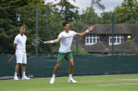 Serbia's Novak Djokovic and his coach Goran Ivanisevic on the practice courts prior to the Wimbledon Tennis Championships in London, Friday June 25, 2021. (Thomas Lovelock/Pool via AP)
