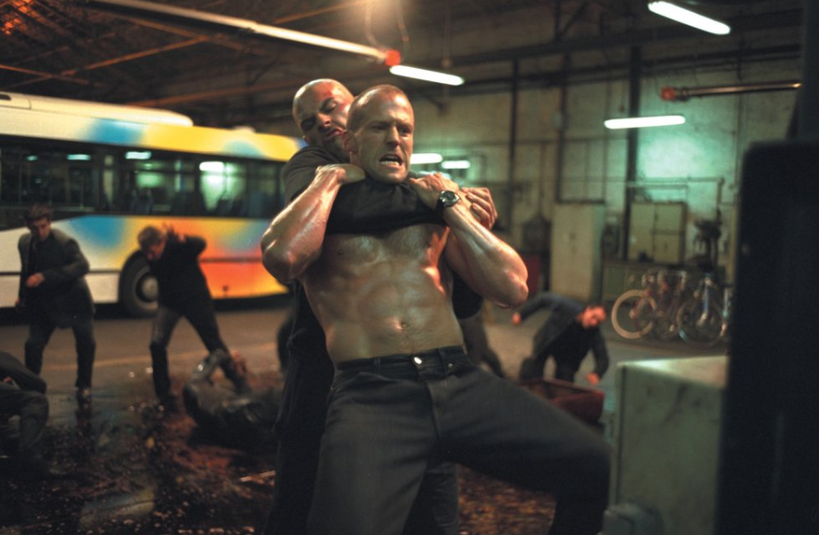 A shirtless Jason Statham gets throttled in a still from <i>The Transporter</i>. (Europacorp)