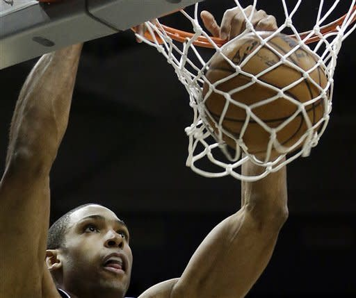Atlanta Hawks' Al Horford dunks during the first half of an NBA basketball game against the Milwaukee Bucks, Sunday, March 24, 2013, in Milwaukee. (AP Photo/Morry Gash)