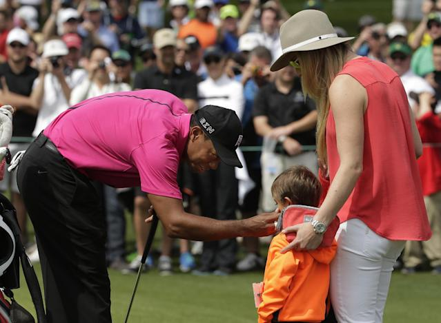 Lindsey Vonn watches as Tiger Woods speaks to his son Charlie during a practice round for the Masters golf tournament Tuesday, April 7, 2015, in Augusta, Ga. (AP Photo/Chris Carlson)