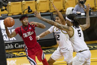 Mississippi's Devontae Shuler, left, passes the ball around Missouri's Mitchell Smith, right, and Dru Smith during the second half of an NCAA college basketball game Tuesday, Feb. 23, 2021, in Columbia, Mo. (AP Photo/L.G. Patterson)