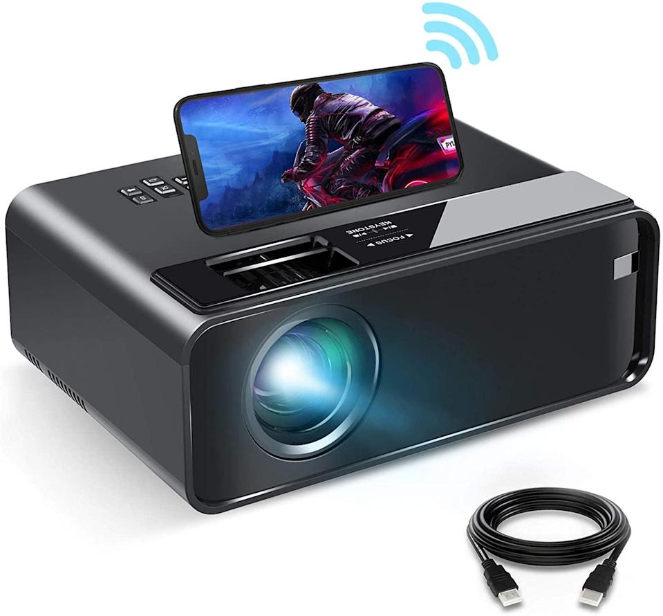 <p>You'll be able to instantly synchronize your smartphone to the <span>Elephas Mini Projector with Synchronize Smartphone Screen</span> ($100) with just a WiFi connection or you can hardwire it! You can watch your favorite shows and movies in HD and with a display of up to 200 inches. It's equipped with the necessary ports you need to enjoy content from streaming sticks, USB drives, laptops, gaming consoles, and more.</p>