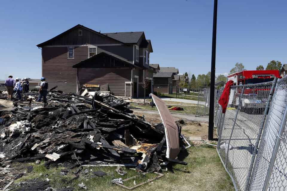 FILE - In this May 4, 2017, file photo, workers dismantle the charred remains of a home at the location where an explosion killed two people in Firestone, Colo. Fire officials said an investigation revealed that the April 17, 2017, explosion was caused by natural gas that was leaking from a small, abandoned flowline from a nearby well. (AP Photo/Brennan Linsley, File)
