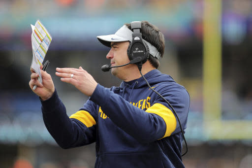 West Virginia head coach Neal Brown calls a timeout in the second quarter of their NCAA college football game against Texas Tech in Morgantown, W.Va., Saturday, Nov. 9, 2019. (AP Photo/Chris Jackson)