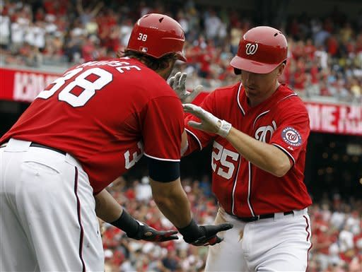 Washington Nationals Michael Morse, left, celebrates with Adam LaRoche after LaRoche's two-run homer in the second inning of a baseball game with the St. Louis Cardinals at Nationals Park Saturday, Sept. 1, 2012, in Washington. (AP Photo/Alex Brandon)